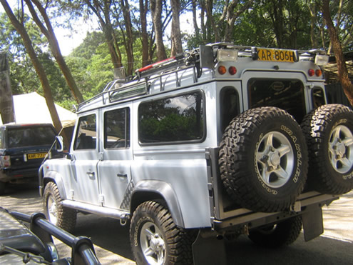 landrover defender,roofhatch,two spare wheels,snorkel,camping equipments,rooftent,long range fuel tank,defender landrover jeep,4x4,kenya,tanzania,uganda,rwanda