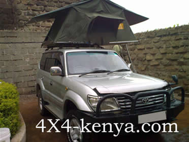 4X4 toyota landcruiser with rooftop tent,camping equipments,roofhatch ,photo safari,self guided safari,kenia 4X4,tansania car rental,dar el salaam,arusha,ruaha park,selfdrive safari,unguided tour,self tour,travel,camping,jeep rental,drive ourself,no guide safari,car hire,